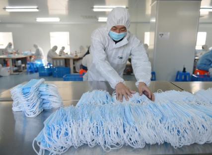 Fabrication de masques de protection, Nanjing, 18 février 2020. AFP